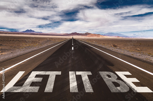 Photo  Let It Be written on desert road