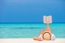 Happy Girl Reading During Tropical White Beach