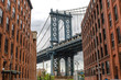 New York City Manhattan Bridge and brick wall building