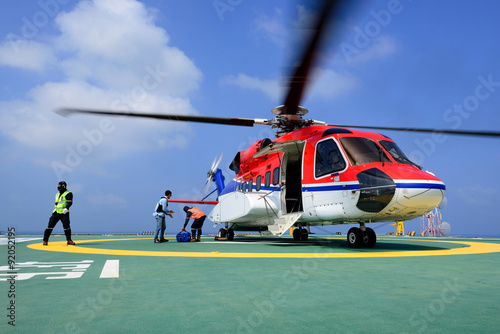 Poster Helicopter The officer take care passenger and load baggage to helicopter a