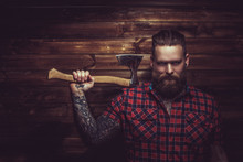Brutal Man With Beard And Tattooe.