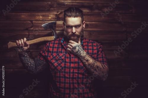 Brutal man with beard and tattooe. Fototapet