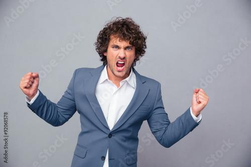 Valokuva  Portrait of angry businessman shouting