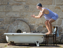 Man In Retro Swimsuit Jumps To...