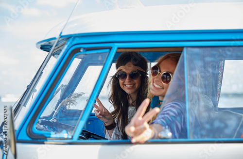 smiling young hippie women driving minivan car фототапет