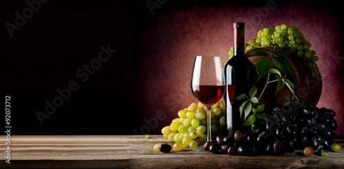 Vine of grape with wine Canvas Print