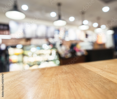 Staande foto Industrial geb. Table top Counter with Blurred Coffee shop cafe Background