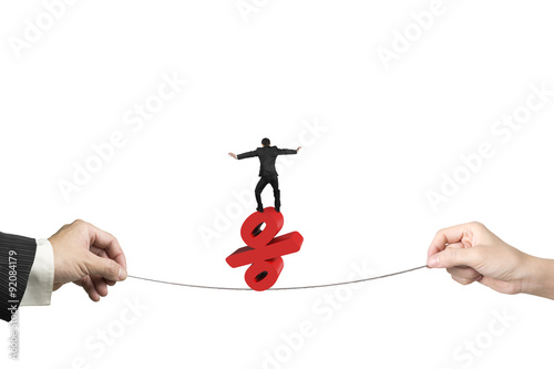 Fotografía  Two hands pulling rope businessman balancing percentage sign