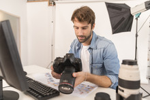 Photographer Working In Office