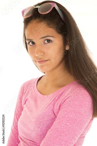 Fotografie, Obraz  Cute Latino girl in a vertical portrait wearing a pink blouse