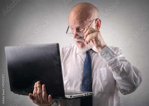 Fotografie, Obraz  Businessman staring at his laptop