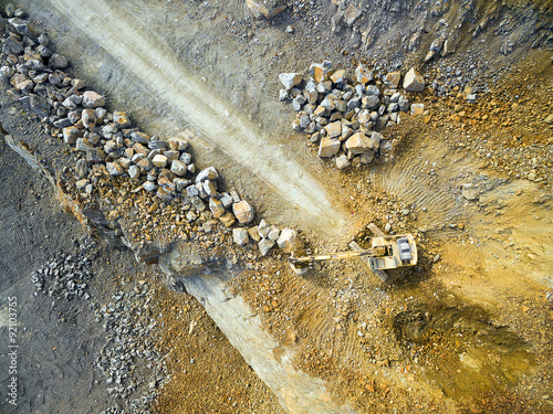 Fotografie, Obraz  Aerial view of a excavator in the mine