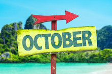 October Directional Sign With Beach Background