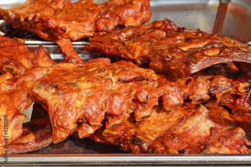Photo Stands Grill / Barbecue Barbecued pork ribs spiced and marinated.