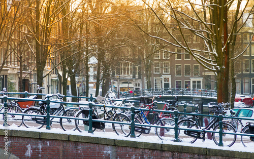 Fototapety, obrazy: Bridge with bicycles in Amsterdam, the Netherlands, early in the morning in winter