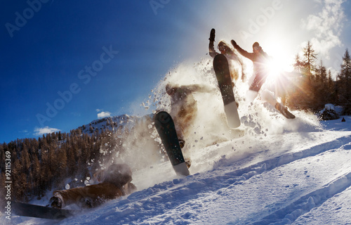Spoed Foto op Canvas Wintersporten Powerful image of a snowboarder jumping over a kicker in the backcountry powder