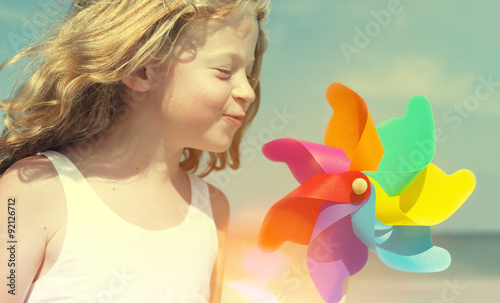 Fotografia, Obraz  Brother Sister Blowing Windmill Beach Enjoyment Concept