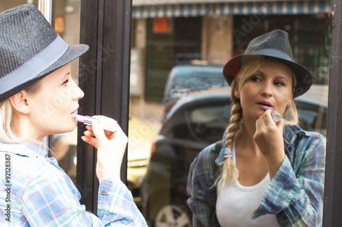 Fotografie, Obraz  blonde girl in the street on lipstick