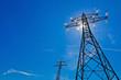 canvas print picture - Strommast mit Sonne vor blauem Himmel