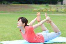 Japanese Woman Doing Yoga Bow Pose