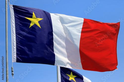 Fotografía  Acadian Flag with Blue Sky Background, Newfoundland, Canada