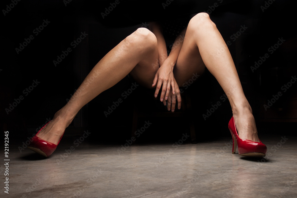 Fototapety, obrazy: Woman wearing red high heel shoes