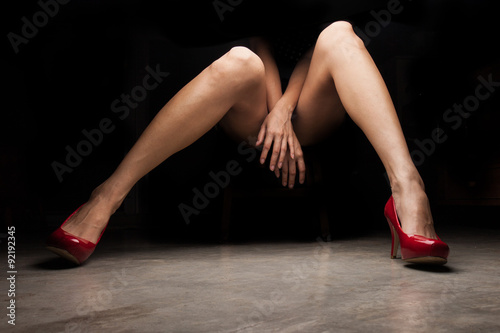 Fotomural Woman wearing red high heel shoes