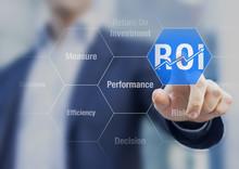 Businessman Using ROI Return On Investment Indicator For Improvement
