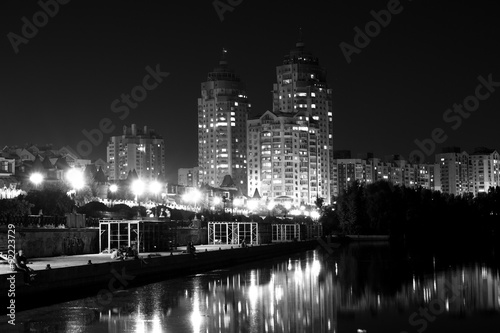 Poster Lights night city with reflections on the river black and white