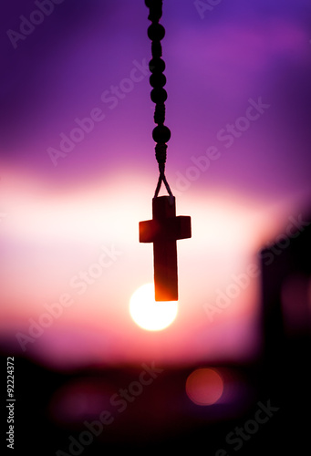 rosary beads with beautiful sunset background Fototapete