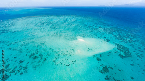 Aerial view of Great Barrier Reef with coral sand cay beach, Australia