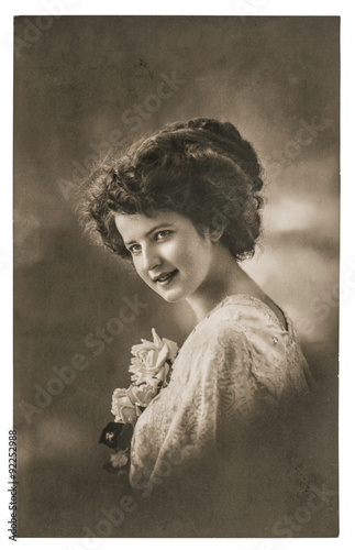 Vintage portrait of young woman with flowers. Retro picture - 92252988