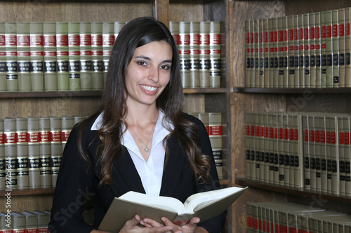 Photo  Young female law student in law library