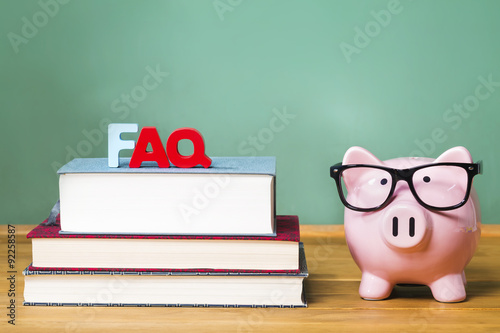 FAQ theme with pink piggy bank with chalkboard Canvas Print
