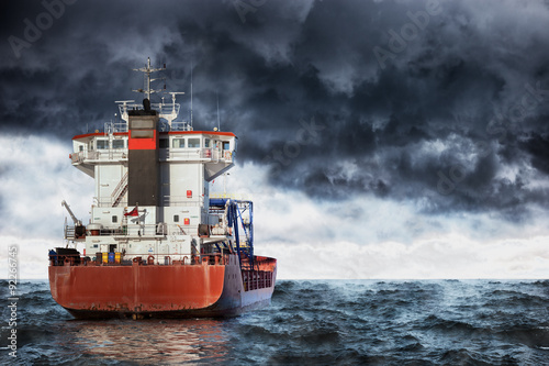 Fotografia  Cargo ship at sea during a storm.