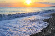Seashore With Pebble Beach At Sunset Sea Tide