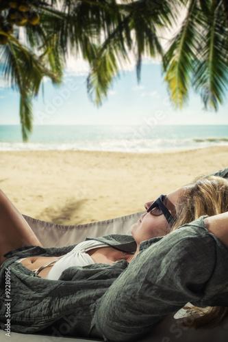 Fototapeta Young beautiful woman relaxing on the hammock obraz na płótnie