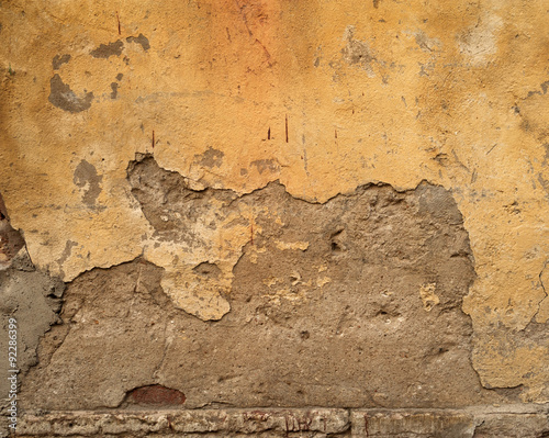 Foto auf AluDibond Alte schmutzig texturierte wand Texture of old wall covered with yellow stucco