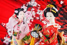 Japanese Dolls On  Red  Backgr...