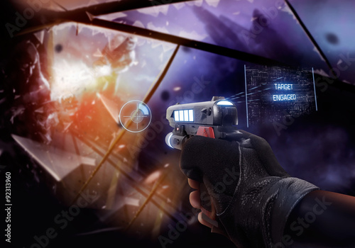 Fotografía  First person view hand in black leather gloves holding a futuristic fantasy neon pointing straight handgun with neon red, blue indicators and panels