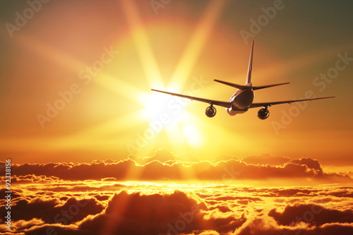Plane is taking off at sunset Canvas Print