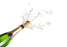 Popping Champagne Bottle On White Background. Celebration, Party And New Year Concept.