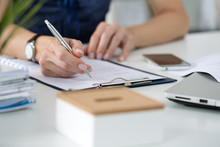 Woman Writing Something  Sitting At Her Office