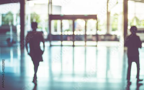 Fotografiet Blur background,silhouette of Business man walking at corridor i