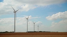 Wind Turbines Landscape 3: Wind Farm In France On A Sunny Day With Puffy Clouds In The Background.