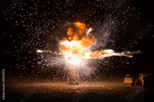 Fotografie, Obraz  Realistic fiery explosion busting over a black background