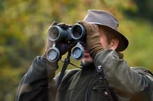 Hunter Looking Through Binocul...