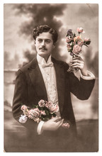 Vintage Portrait Of Young Man With Rose Flowers