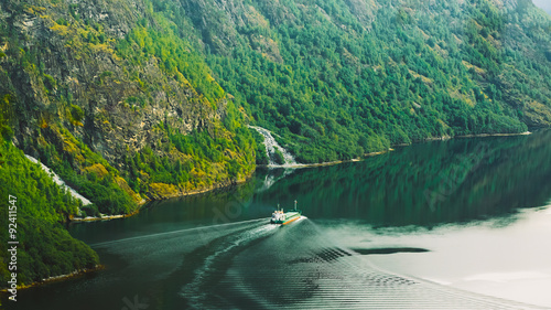 Photo sur Toile Europe du Nord The ship floating in the water in narrowest fjord in Norway - Na