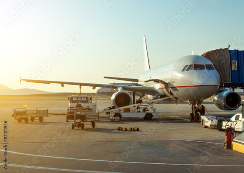 Photo  Passenger plane in the airport at sunrise. Aircraft maintenance.